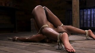 Tight manacles are keeping that naked black babe in place