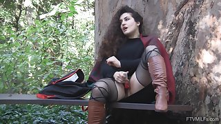 Outdoor solo clothed masturbation session with curly haired Lili
