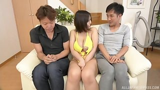 Busty Japanese babe Tsukada Shiori fucked hard by two guys at home